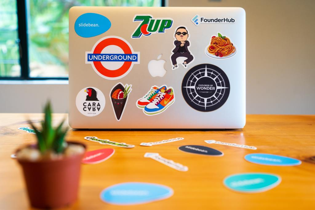 Photo by Slidebean on Unsplash - Downloaded from Unsplash - It is a laptop covered in stickers to better highlight the power of branding.